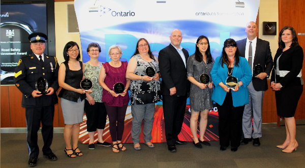 the Ministry of Transportation presenting a Road Safety Achievement Award to the Toronto Vision Zero Active and Safe Routes to School Partnership - Ontario Active School Travel
